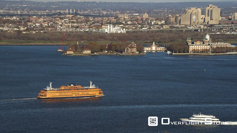 Staten Island Ferry near Ellis Island with New Jersey shoreline in background.