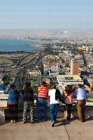 Chilean family looking at view over city from El Morro headland, Arica, Region XV, Chile