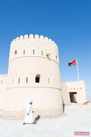 Oman, Sur. Omani man walking into Sunaysilah old fortress