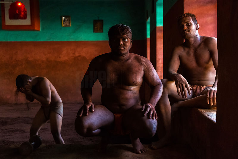 Portrait of Kushti Wrestlers Taking a Break from Training