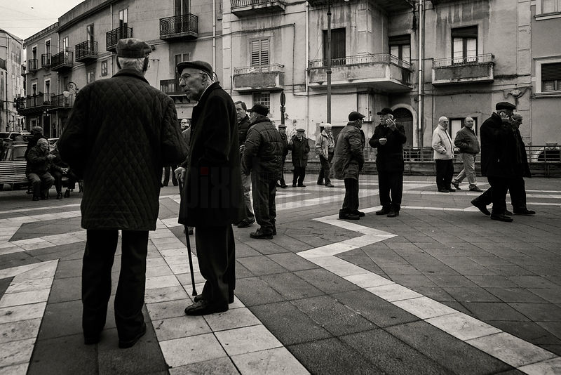 Men Enjoying the Passegiata in the Square at Centuripe