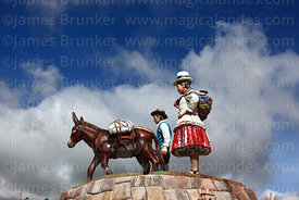 Monument showing local inhabitants in Plaza de Armas, Maras, Cusco Region, Peru