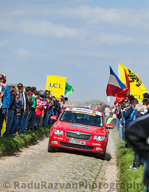 Official Red Car on the Roads of Paris Roubaix Cycling Race