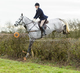 Flo Hillen jumping a hedge on Graham Smith's