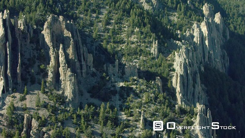 Dramatic pillars of rock rise on the edge of a canyon in the high desert of southern Montana