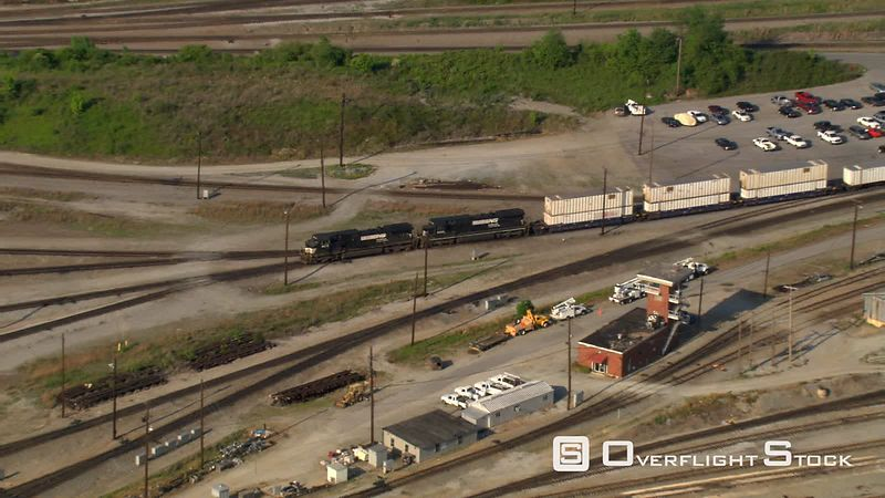 Aerial zoom-out of railyard near Atlanta, Georgia.