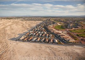 Aerial photograph of North Las Vegas suburbs abutting the Nevada desert.