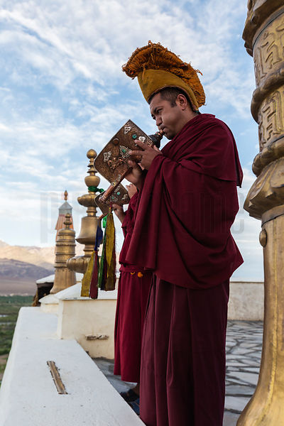 Portrait Monks Playing Call to Prayer on Conch Horns