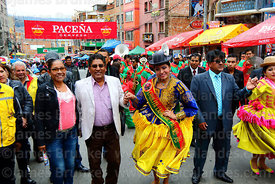 La Paz Department governor Feliz Patzi dances with his wife Massiel Terrazas and the official cholita during parades for the Entierro del Pepino, La Paz, Bolivia