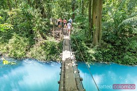 Suspension wooden bridge crossing Rio Celeste river, Costa Rica