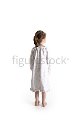 A little barefoot girl in a night dress – shot from mid level.