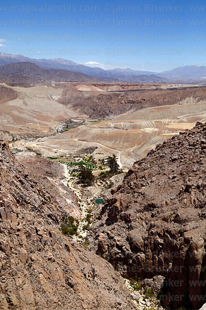 View down rocky canyon to small oasis village of of Copaquilla, Region XV, Chile