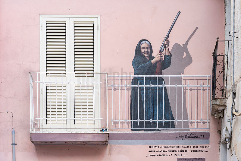 A Mural Depicting a Woman Holding a Shotgun