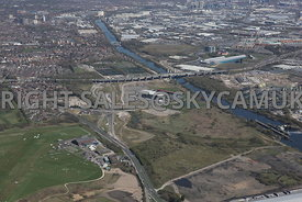 Liverpool Road, Peel Green, Eccles, high level view showing the infrastructure, M60 motorway, the Manchester Ship Canal and A J Bell Stadium and the land surrounding the stadium development being developed by the Peel Group