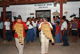 Musicians playing Yuruhys (Bajones Chicos) leaving the Mojeño Cabildo (parliament) building for a procession, San Ignacio de Moxos, Bolivia