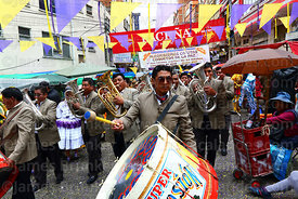 A brass band in action during parades for the Entierro del Pepino, La Paz, Bolivia
