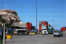 Containers stacked up in port, El Morro headland in background, Arica, Region XV, Chile