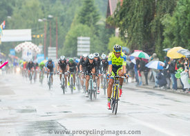 The Peloton Riding in the Rain - Tour de France 2014