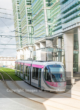 Electric tram in Snow Hill, Birmingham City Centre. England.