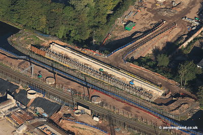 aerial photograph of the new canal and railway bridges under construction over the A38 in Brimingham England UK
