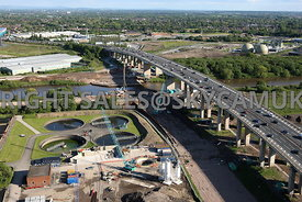 Manchester aerial photograph of the construction of the new bridge crossing the Manchester Ship Canal with the M 60 motorway crossing the Barton high level motorway bridge