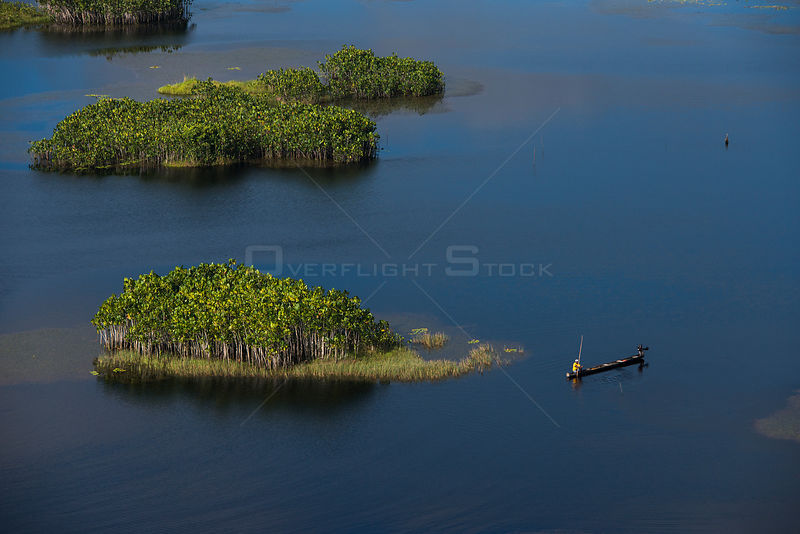 Fisherman in boat in West Demerara Conservancy, west of Georgetown, Guyana, South America
