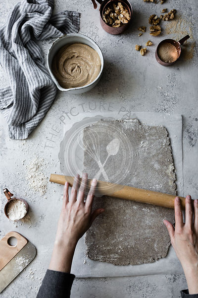 Preparation and cooking of a Maple Buckwheat Apple Galette with Walnut Frangipane. Rolling out an alternative flour pastry.