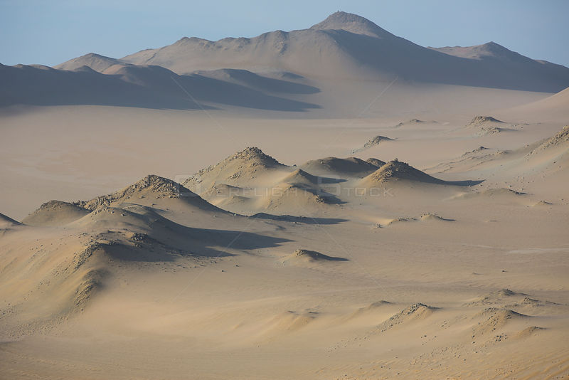 Aerial view of Nazca coastal desert with sand dunes in Paracas National Reserve, Peru