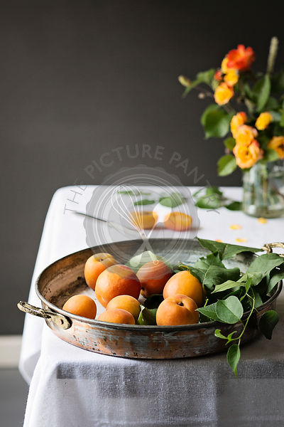Fresh apricots in a old tray