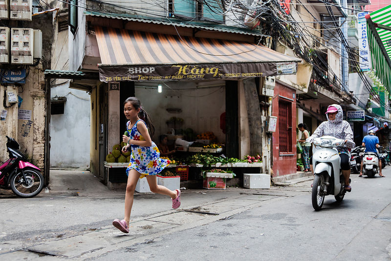 Girl Running in Street in Old Hanoi