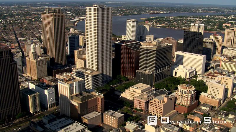 Flying over New Orleans skyscrapers to river.