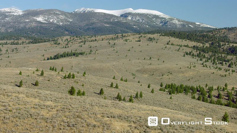 Wide open sagebrush covered meadows and dense forests cover the foothills of the Gravelly mountain range in southwestern Montana