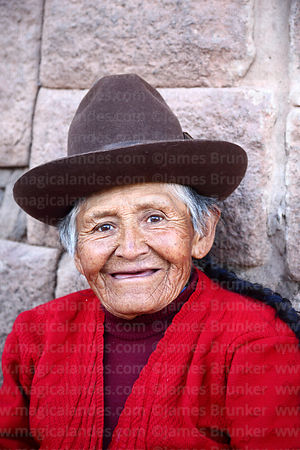Portrait of old Quechua woman from Chinchero in front of Inca walls , Cusco , Peru