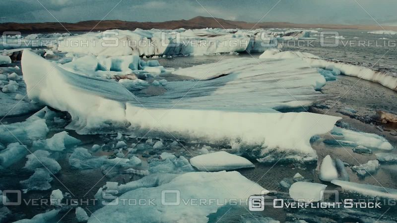 Aerial View of Melting Icebergs at Jokulsarlon Glacier, Filmed by Drone, Iceland