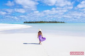 Woman walking on deserted beach, Aitutaki, Cook Islands