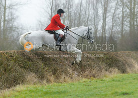 Tom Kingston jumping the first hedge