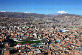 Former Bolivar football stadium in Tembladerani , Mts Mururata (L) and Illimani (R) in background , La Paz , Bolivia