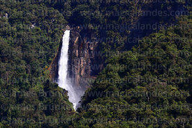 View of the Rincon del Tigre waterfall near Taypiplaya from a distance, Caranavi Province, Bolivia