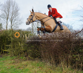 Richard Hunnisett MFH jumping the first hedge - Barleythorpe