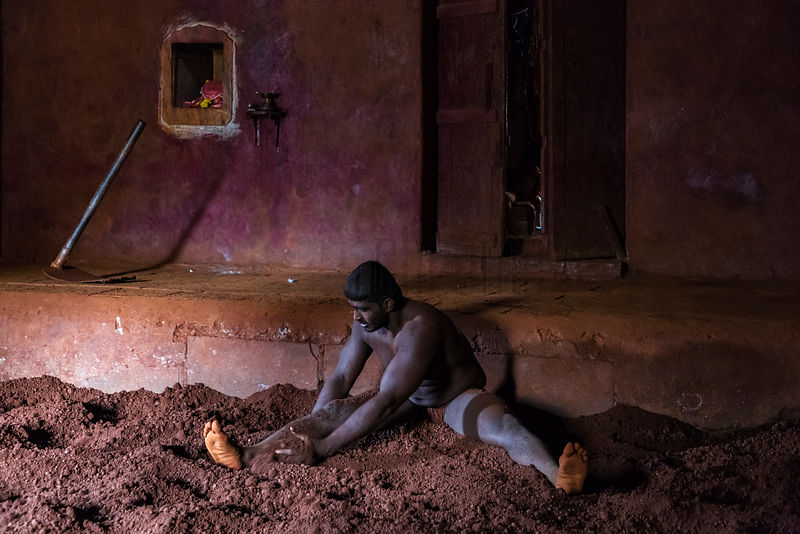 Kushti Wrestler Rubbing Sand onto his Body