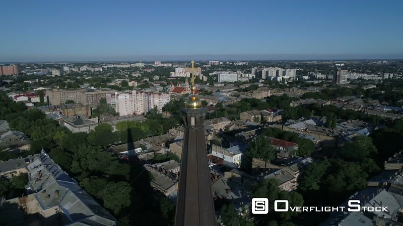 Drone camera flies slowly back from the cross on top of Preobrazhensky Cathedral on Saborna Square in Odessa Ukraine. Taken on a crystal clear summer morning