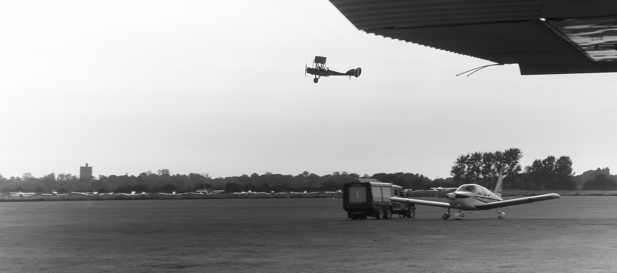 Antique Style Image of Bi-plane take-off at airfield