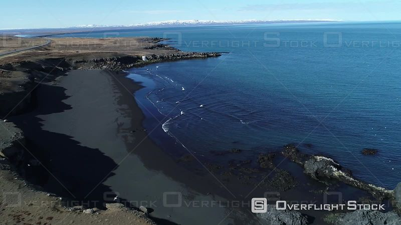 Aerial View of a Cascade and a Black Sand Beach, Filmed by Drone, Iceland