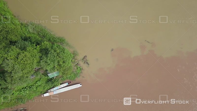 Aerial view of muddy water on Mekong river, filmed by drone, Luang Prabang, Laos