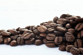 Pile of roasted coffee beans on white background.
