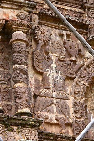 Detail of figure on upper left side of main entrance facade of Santa Cruz of Jerusalem church, Juli, Puno Region, Peru