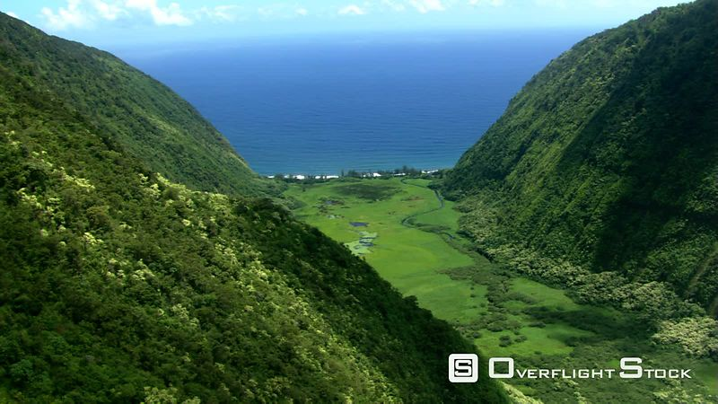 Flying down Hawaii's Waipio Canyon toward the ocean