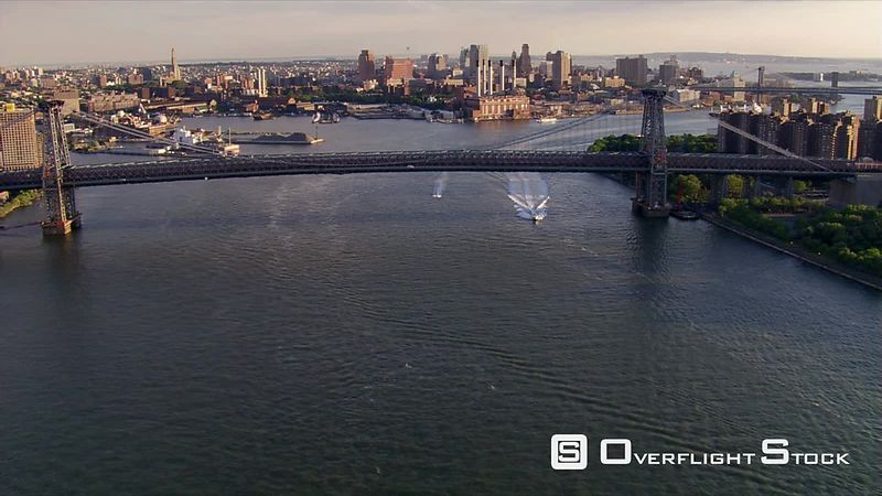 Flight over Williamsburg Bridge and up New York's East River.