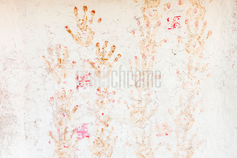 Stamped Hand Prints on a Plaster Wall