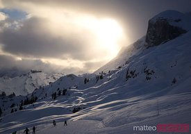 Skiers at sunset in the Dolomites